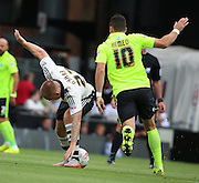 Jamie O'Hara battling with Tomer Hemed during the Sky Bet Championship match between Fulham and Brighton and Hove Albion at Craven Cottage, London, England on 15 August 2015. Photo by Matthew Redman.