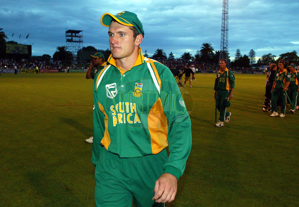 17  March 2004. New Zealand vs South Africa International one day cricket at McLean Park, Napier, New Zealand. Match 6 in series of 6..South African captain Graeme Smith looks disappointed as he leaves the field at the end of the match.  New Zealand defeated South Africa by 5 wickets to win the 6 match series 5-1..Pic: Andrew Cornaga/Photosport