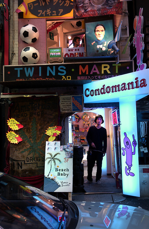 Condomania - a strang blend of football and neon at a Shibuya  shop specialising in the sale of all varieties of condom. Tokyo 13 06 02..©David Dare Parker/AsiaWorks Photography