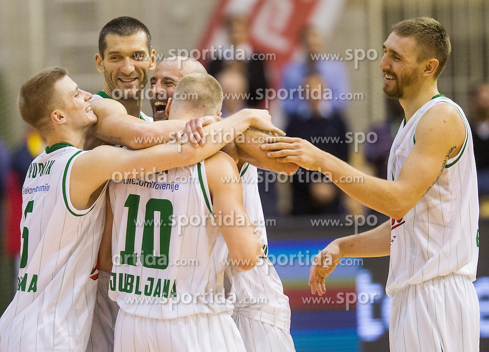 Luka Rupnik of Union Olimpija, Dragisa Drobnjak of Union Olimpija, Nebojsa Joksimovic of Union Olimpija, Sasu Antreas Salin of Union Olimpija and Deividas Gailius of Union Olimpija celebrate after winning during Super Cup 2013 basketball match between KK Krka and KK Union Olimpija before new season 2013/14 on October 2, 2013 in Sports hall Lucija, Portoroz, Slovenia. Union Olimpija defeated Krka 63-60 and became Super Cup Champion 2013. (Photo by Vid Ponikvar / Sportida.com)