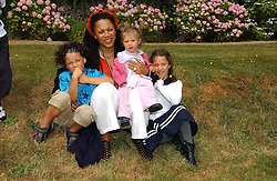 "Nimmy Burke with her children Malachy, Lottie & Khaya at the Goodwood Festival of Speed on 9th July 2006.  Cartier sponsored the ""Style Et Luxe' for vintage cars on the final day of this annual event at Goodwood House, West Sussex and hosted a lunch.<br />