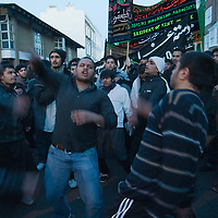 .LONDON, ENGLAND - DECEMBER 27:  Shiite worshippers beat on their chest during the Ashura procession in Central London on December 27, 2009 in London, England.Ashura is a 10 day period of mourning for Imam Hussein, the seven-century grandson of Prophet Mohammad who was killed in a battle in Karbala in Iraq, in 680 AD...***Agreed Fee's Apply To All Image Use***.Marco Secchi /Xianpix. tel +44 (0) 771 7298571. e-mail ms@msecchi.com .www.marcosecchi.com