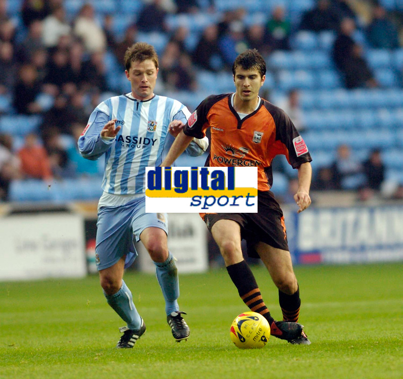 Photo: Leigh Quinnell.<br /> Coventry City v Ipswich Town. Coca Cola Championship.<br /> 19/11/2005. Coventrys Stephen Hughes gets ready to challenge Ipswichs' Jimmy Juan.