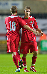 SWANSEA, ENGLAND - Friday, September 4, 2009: Wales' Aaron Ramsey celebrates with team-mate Ched Evans after their 2-1 victory over Italy during the UEFA Under 21 Championship Qualifying Group 3 match at the Liberty Stadium. (Photo by David Rawcliffe/Propaganda)