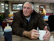 """MONTICELLO, IA – JANUARY 6: Sitting at the """"Table of Knowledge"""" LaRoy Rickeln looks on over breakfast at Darrell's in Monticello, Iowa on January 6, 2017."""