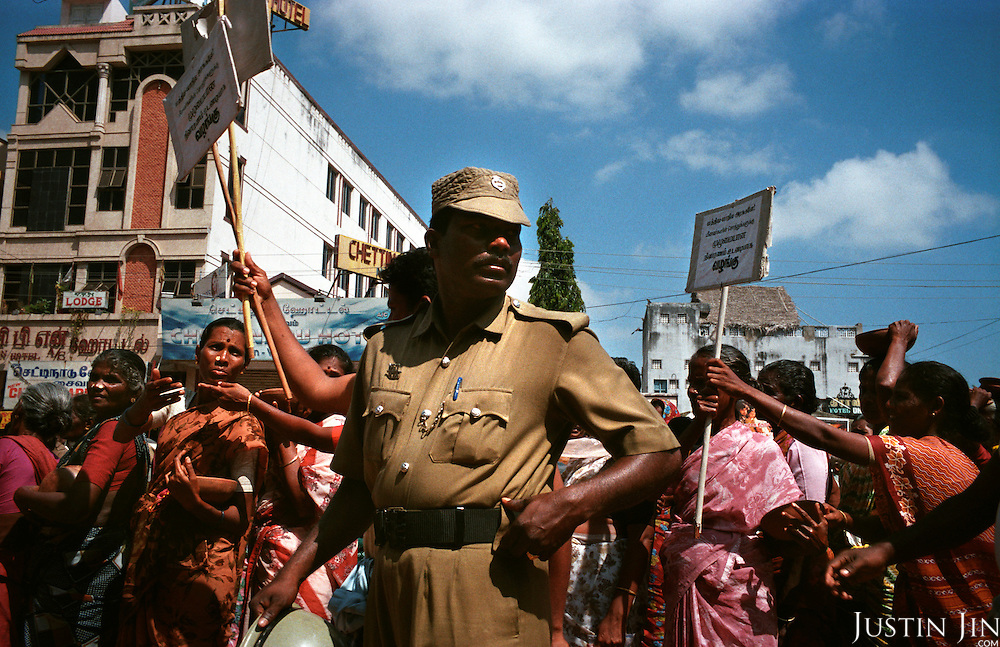 Women in Nagappattinam, on the southeastern coast of India, protest against inadequate relief for tsunami victims and their families. .The December 26, 2004 tsunami killed thousands of people along this coast, smashing boats, roads and houses and tearing thousands of families apart. .Picture taken February 2005 in Nagapptinam, Tamil Nadu, India, by Justin Jin