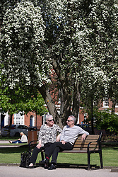 © Licensed to London News Pictures . 14/05/2014 . Leeds , UK . People enjoy the sunshine in Park Square , Leeds, this afternoon , as temperatures soar in to the 20s . Photo credit : Joel Goodman/LNP