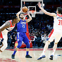 09 December 2017: LA Clippers guard Austin Rivers (25) passes the ball past Washington Wizards center Ian Mahinmi (28) and Washington Wizards guard Tomas Satoransky (31) during the LA Clippers 113-112 victory over the Washington Wizards, at the Staples Center, Los Angeles, California, USA.
