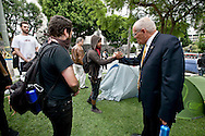 Occupy LA in Los Angeles. Hundreds of protesters are sleeping on the lawn of LA City Hall to protest corporate greed. L.A. City councilman Bill Rosendahl, 11th council district, shakes hands with a Occupy LA protester on the lawn of LA City Hall.