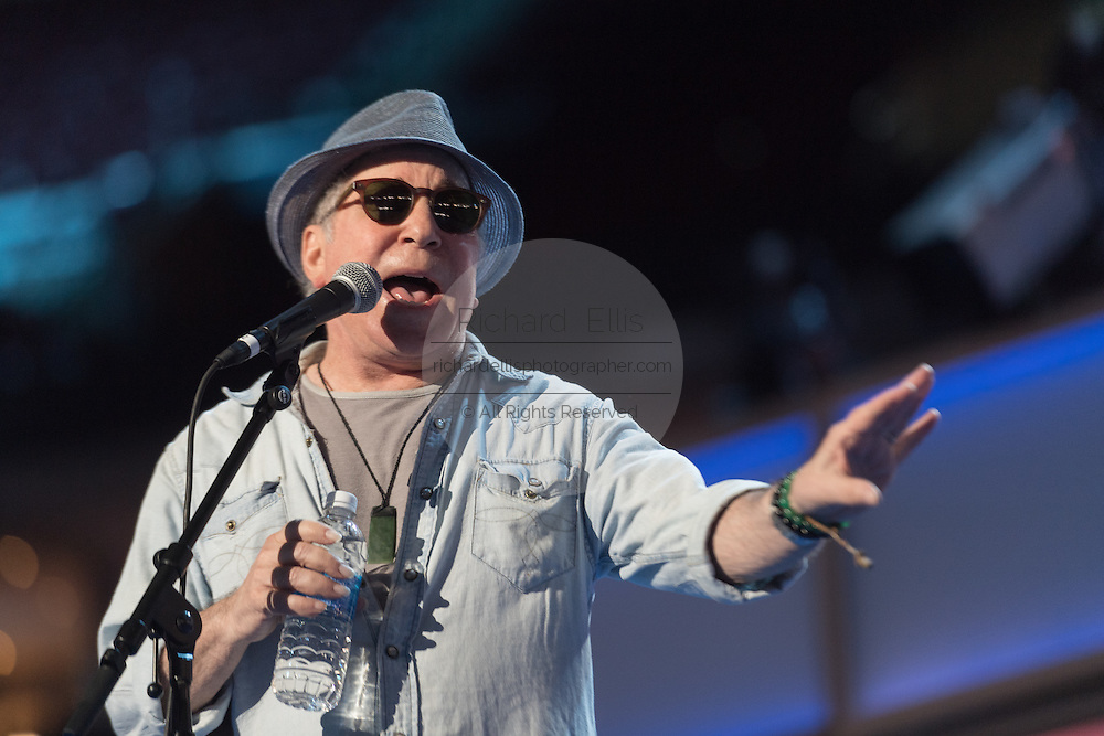 Legendary singer Paul Simon sings during rehearsal preparations for the start of the Democratic National Convention at the Wells Fargo Center July 24, 2016 in Philadelphia, Pennsylvania.