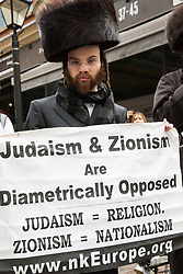 London, UK. 30th March, 2019. An Orthodox Haredi Jew from Neturei Karta UK joins pro-Palestinian campaigners at a Rally for Palestine outside the Israeli embassy to demand freedom, justice and equality for the Palestinian people. The rally was organised by Palestine Solidarity Campaign, Stop the War Coalition, Palestinian Forum in Britain, Friends of Al- Aqsa and Muslim Association of Britain.