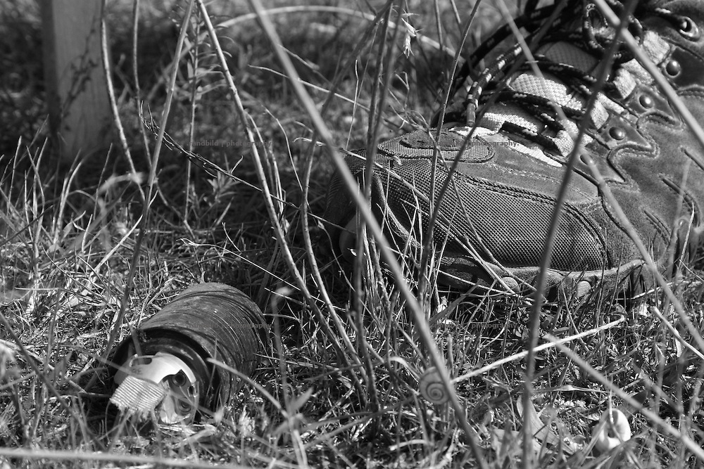 A georgian cluster bomb. Local georgians while a mine clearance training operated by Halo Trust in the so called bufferzone between Gori and Tskhinvali, few days after the withdrawal of the russian forces from the area. The bufferzone was etablished after a short war in August 2008 as the georgian army assulted South Ossetia to overthrow the local separatist government.