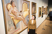 UNITED KINGDOM, London: 08 May 2019 <br /> Dr Victoria Bateman stands next to her portrait painted by Anthony Connolly at the launch of The Royal Society of Portrait Painters' annual exhibition at The Mall Galleries, London. <br /> The exhibition consists of faces both famous and not-so famous and is a celebration of the very best in contemporary portraiture nationally and internationally.<br /> Rick Findler