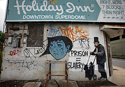 31 May 2010. New Orleans, Louisiana, USA.  <br /> Banksy street graffiti of Lincoln as a homeless vagrant in downtown New Orleans. The building has since been demolished. It is unknown if any part of the wall was saved? Banksy visited the city in 2008.<br /> Photo; Charlie Varley.