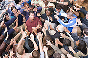 Young man surrounded by crowd