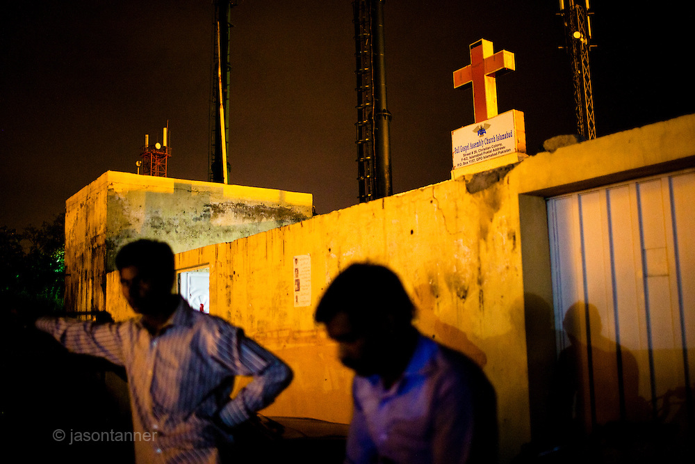 Islamabad: Young men wait outside the Gospel Assembly Church, one of several churches at the Christian colony in Islamabad...Pakistan's Christian communities account for an estimated one percent of the country's 180 million population...I the middle of Islamabad's wealthiest neighbourhood is a 'colony' that's home to some 4000 Christians. Narrow alleys separate multi-storey, squalid houses with open sewers running meandering the alleys to the river that runs through the heart of the colony...Some are recent arrivals from Faisalabad and Gojra, where recent sectarian killings forced many to relocate to the relative safety of the capitol territory. Many are second and third generation residents squatting on land that sees no development assistance from the Capital Development Authority. Power outages are frequent, many residents sleep on the roofs during the long summer months, there are no air-conditioners in the colony...Many of the residents are unemployed; those fortunate to have any income usually work as servants, gardeners, drivers, security guards or cleaners. ..Discrimination against the Christian minorities is rampant in Pakistani society. Many suspect the government of deliberately keeping them at the bottom of the economic ladder to appease the radical religious parties...©JTanner/August2011