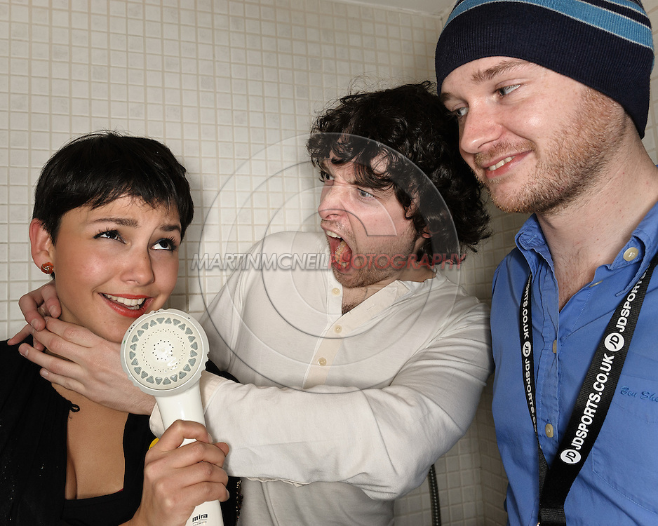 GLASGOW, SCOTLAND, NOVEMBER 28, 2008: TV Presenter Shantha Roberts interviews Attic Lights band members Kevin Sherry (C) and Colin McArdle inside a backstage shower cubicle during the St. Andrews Day concert for Versus Cancer at the Glasgow Carling Academy November 28, 2008 in Glasgow, Scotland