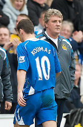 WIGAN, ENGLAND - Sunday, March 16, 2008: Wigan Athletic's Jason Koumas walks past manager Steve Bruce after being sent off in the opening minutes of the Premiership match against Bolton Wanderers at the JJB Stadium. (Photo by David Rawcliffe/Propaganda)