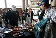 Cass Lowe, center, greets diners to the Thanksgiving meal at Energy Solutions Arena sponsored by the Salt Lake City Mission, Utah Food Services and the Utah Jazz, Tuesday, Nov. 20, 2012.
