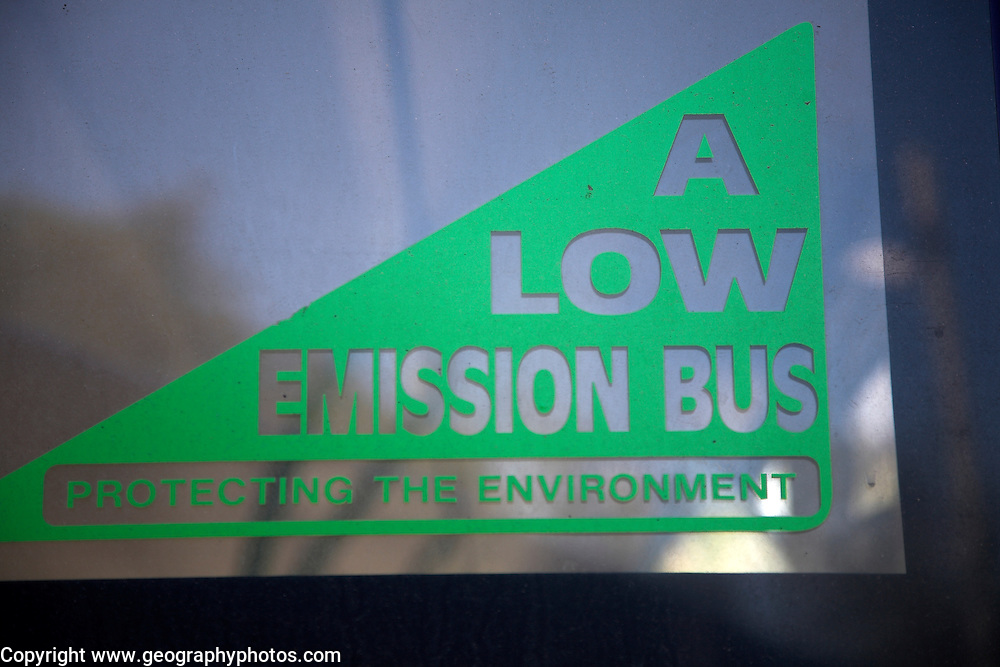 A Low Emission Bus, protecting the environment, sign on back windscreen