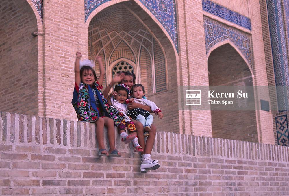 Uzbek children in front of Mir-i-Arab Medressa, Bukhara, Uzbekistan