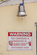 Security guard dog warning in Nassau , Bahamas.