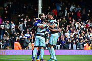 Queens Park Rangers midfielder Tjaronn Chery (10) congratulates Queens Park Rangers goalkeeper Alex Smithies (1) on saving a second penalty during the EFL Sky Bet Championship match between Fulham and Queens Park Rangers at Craven Cottage, London, England on 1 October 2016. Photo by Jon Bromley.