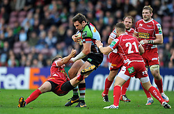 Harlequins replacement Tom Guest takes on the Scarlets defence - Photo mandatory by-line: Patrick Khachfe/JMP - Tel: Mobile: 07966 386802 12/10/2013 - SPORT - RUGBY UNION - Twickenham Stoop - London - Harlequins V Scarlets - Heineken Cup