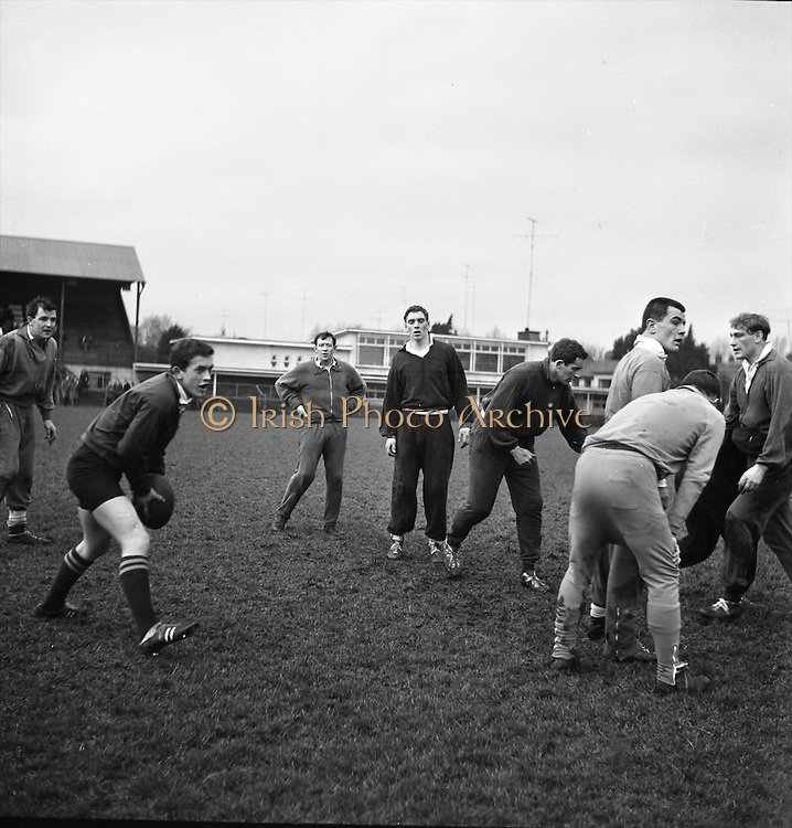 T J Kiernan, the Cork fullback, catches a ball during practice with his team at Anglesea Road, Dublin, Friday 20th January, 1967,..Irish Rugby Football Union, Ireland v Australia, Ireland team pracrtice, Dublin, Ireland, Friday 20th January, 1967,.20.1.1967, 1.20.1967,  Referee- M Joseph, Welsh Rugby Union, ..Score- Ireland 15 - 8 Australia, ..Irish Team, ..T J Kiernan,  Wearing number 15 Irish jersey, Full Back, Cork Constitution Rugby Football Club, Cork, Ireland,..A T A Duggan, Wearing number 14 Irish jersey, Right Wing, Landsdowne Rugby Football Club, Dublin, Ireland,..F P K Bresnihan, Wearing number 13 Irish jersey, Right Centre, University College Dublin Rugby Football Club, Dublin, Ireland, ..H H Rea, Wearing number 12 Irish jersey, Left Centre, Edinburgh University Rugby Football Club, Edinburgh, Scotland, ..P J McGrath,  Wearing number 11 Irish jersey, Left Wing, University college Cork Rugby Football Club, Cork, Ireland,  ..C M H Gibson, Wearing number 10 Irish jersey, Stand Off, N.I.F.C, Rugby Football Club, Belfast, Northern Ireland, ..B F Sherry, Wearing number 9 Irish jersey, Scrum Half, Terenure Rugby Football Club, Dublin, Ireland, ..K G Goodall, Wearing number 8 Irish jersey, Forward, Newcastle University Rugby Football Club, Newcastle, England, ..M G Doyle, Wearing number 7 Irish jersey, Forward, Edinburgh Wanderers Rugby Football Club, Edinburgh, Scotland, ..N Murphy, Wearing number 6 Irish jersey, Forward, Cork Constitution Rugby Football Club, Cork, Ireland,..M Molloy, Wearing number 5 Irish jersey, Forward, University College Galway Rugby Football Club, Galway, Ireland,  ..W J McBride, Wearing number 4 Irish jersey, Forward, Ballymena Rugby Football Club, Antrim, Northern Ireland,..P O'Callaghan, Wearing number 3 Irish jersey, Forward, Dolphin Rugby Football Club, Cork, Ireland, ..K W Kennedy, Wearing number 2 Irish jersey, Forward, C I Y M S Rugby Football Club, Belfast, Northern Ireland, ..T A Moroney, Wearing number 1 Irish jersey, Forward,