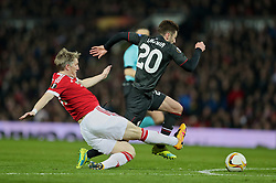 MANCHESTER, ENGLAND - Wednesday, March 16, 2016: Liverpool's Adam Lallana is hacked down by Manchester United's Bastian Schweinsteiger during the UEFA Europa League Round of 16 2nd Leg match at Old Trafford. (Pic by David Rawcliffe/Propaganda)