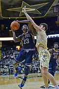 Kent State Golden Flashes guard Jaylin Walker (23) shoots against Vanderbilt Commodores forward Yanni Wetzell (1) during the second half of an NCAA basketball game in Nashville, Tenn., Friday, Nov. 23, 2018. Kent State won 77-75. (Jim Brown/IOS via AP)