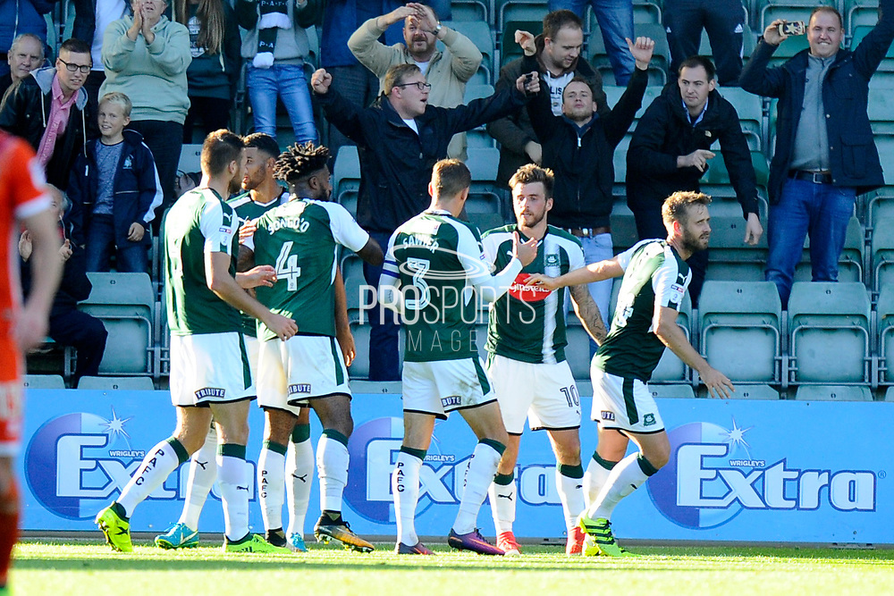 Graham Carey (10) of Plymouth Argyle celebrates scoring a goal to give a 1-0 lead to the home team during the EFL Sky Bet League 1 match between Plymouth Argyle and Shrewsbury Town at Home Park, Plymouth, England on 14 October 2017. Photo by Graham Hunt.