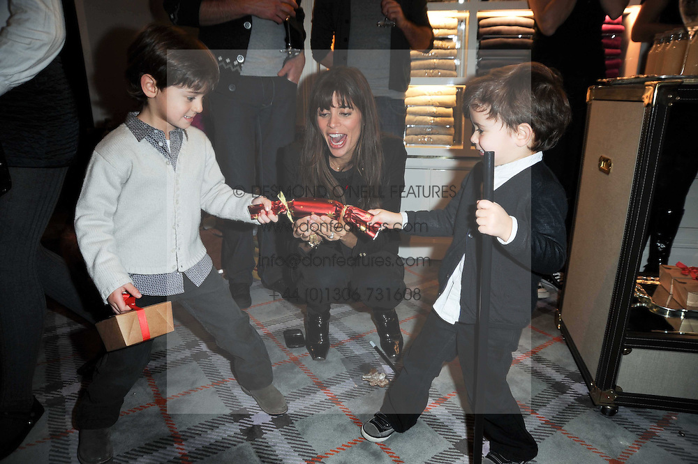 LISA B and her sons, left ORLANDO and right NOAH at the Juicy Couture children's tea party in aid of Mothers 4 Children held at the Juicy Couture Store, Bruton Street, London on2nd December 2009.