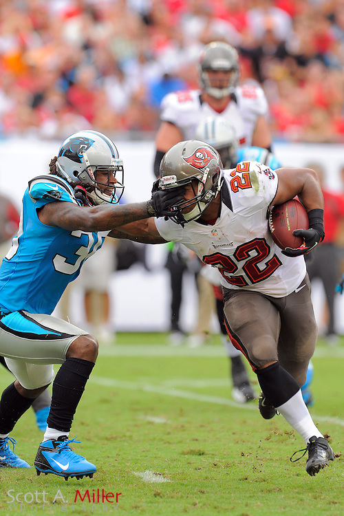 Tampa Bay Buccaneers running back Doug Martin (22) is tackled by Carolina Panthers strong safety Charles Godfrey (30) during their game at  Raymoind James Stadium  on September 9, 2012 in Tampa, Florida. .©2012 Scott A. Miller...