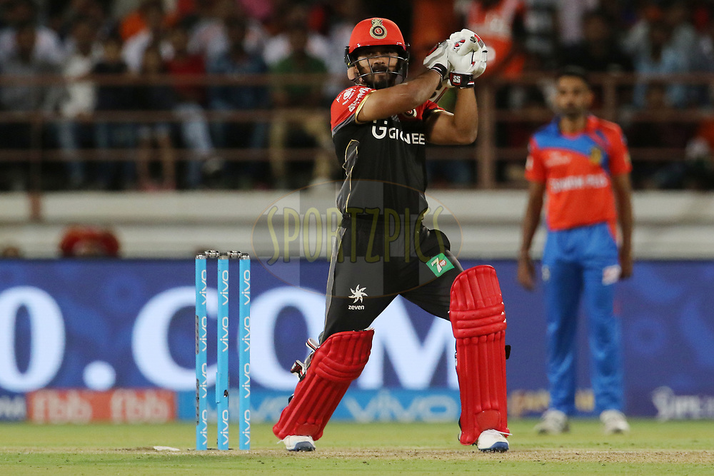 Kedar Jadhav of the Royal Challengers Bangalore plays a shot during match 20 of the Vivo 2017 Indian Premier League between the Gujarat Lions and the Royal Challengers Bangalore  held at the Saurashtra Cricket Association Stadium in Rajkot, India on the 18th April 2017<br /> <br /> Photo by Vipin Pawar - Sportzpics - IPL
