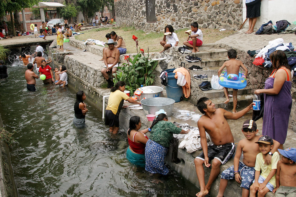 Bathing, laundry, snacktime and just plain fun in the aquaduct at Los Pinos, Mexico, near Cuernavaca. (Supporting image from the project Hungry Planet: What the World Eats.)