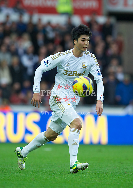 SWANSEA, WALES - Sunday, December 23, 2012: Swansea City's Ki Sung-Yeung in action against Liverpool during the Premiership match at the Liberty Stadium. (Pic by David Rawcliffe/Propaganda)