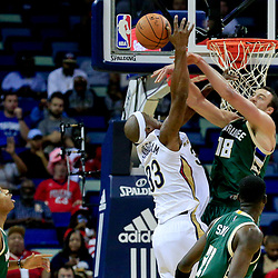Nov 1, 2016; New Orleans, LA, USA; Milwaukee Bucks center Miles Plumlee (18) blocks a shot by New Orleans Pelicans forward Dante Cunningham (33) during the first quarter of a game at the Smoothie King Center. Mandatory Credit: Derick E. Hingle-USA TODAY Sports