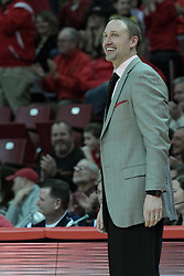 15 February 2014:  Head Coach Dan Muller smile a note of great satisfaction and pride as Matt Stacho's shot hits the mark during an NCAA Missouri Valley Conference (MVC) mens basketball game between the Bradley Braves and the Illinois State Redbirds  in Redbird Arena, Normal IL.