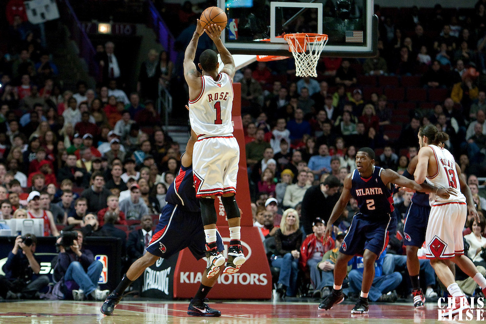 19 December 2009: Chicago Bulls guard Derrick Rose goes for a jumpshot during the Chicago Bulls 101-98 victory in overtime over the Atlanta Hawks at the United Center, in Chicago, Illinois, USA.