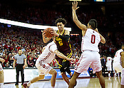 Guard Amir Coffey (5) drives through traffic during the second half of the University of Minnesota Men's Basketball game versus University of Wisconsin on March 5, 2017.