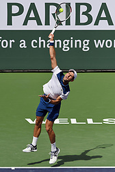 March 11, 2018 - Indian Wells, CA, U.S. - INDIAN WELLS, CA - MARCH 11: Novak Djokovic (SRB) serving in the second set of a match played at the BNP Paribas Open on March 11, 2018 at the Indian Wells Tennis Garden in Indian Wells, CA. (Photo by John Cordes/Icon Sportswire) (Credit Image: © John Cordes/Icon SMI via ZUMA Press)