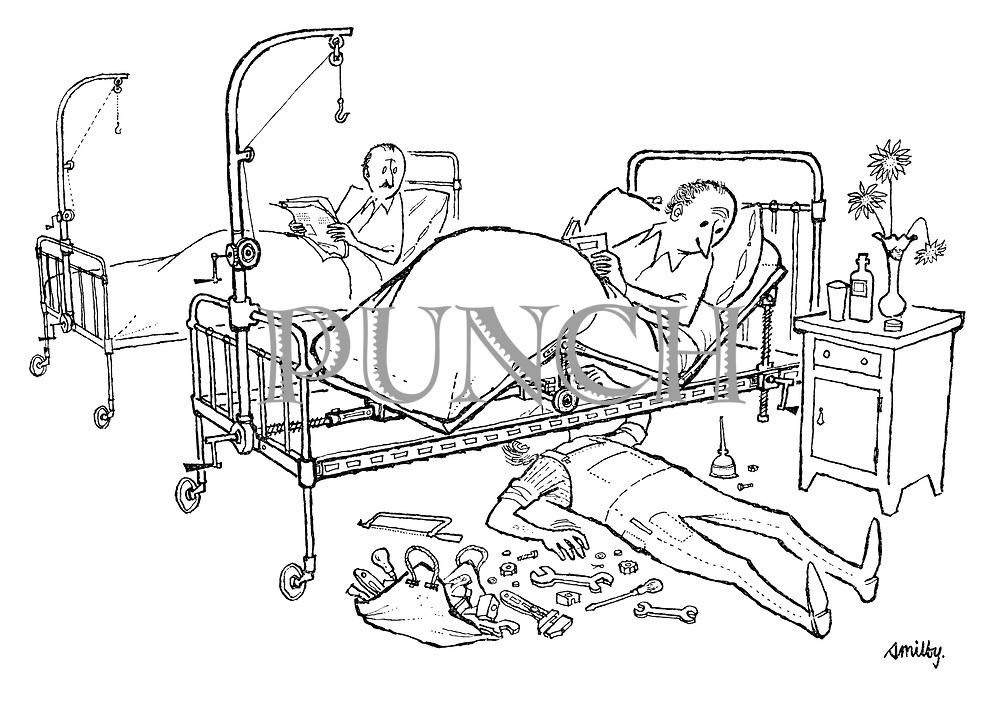 (Man underneath hospital bed fixing it like a car mechanic)