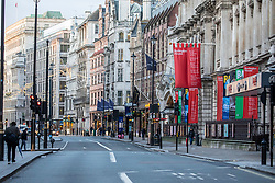 © Licensed to London News Pictures. 23/12/2019. Regent Street normally packed with traffic remains empty as shops in the West End prepare for last minute Christmas shoppers. Alex Lentati/LNP