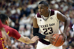 Texas A&M's Danuel House (23) looks to pass against Iowa State's Abdel Nader (2) during the first half of an NCAA college basketball game, Saturday, Jan. 30, 2016, in College Station, Texas. Texas A&M won 72-62. (AP Photo/Sam Craft)