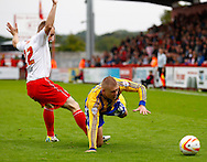 Picture by David Horn/Focus Images Ltd +44 7545 970036<br /> 12/10/2013<br /> David Gray of Stevenage fouls Jake Bidwell of Brentford during the Sky Bet League 1 match at the Lamex Stadium, Stevenage.