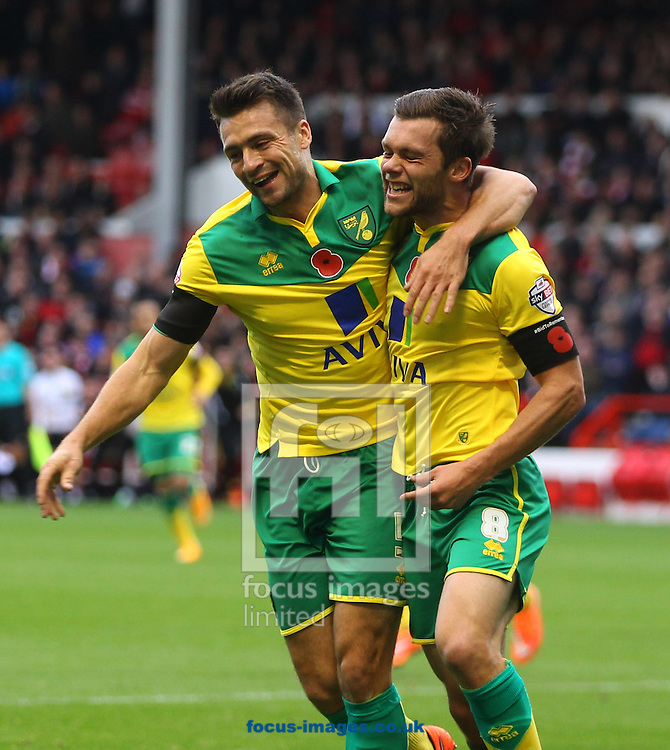 Jonny Howson of Norwich scores his sides 1st goal and celebrates with Russell Martin of Norwich during the Sky Bet Championship match at the City Ground, Nottingham<br /> Picture by Paul Chesterton/Focus Images Ltd +44 7904 640267<br /> 08/11/2014