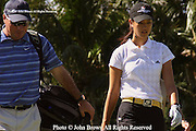 Fifteen year old Michelle walks down the fairway with her caddy after a tee shot during a practice round prior to The 2005 Sony Open In Hawaii. The event was held at The Waialae Country Club in Honolulu.