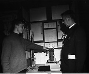 1973.5/1/73.1/5/73.5th January 1973 .The Aer Lingus Young Scientist Exhibition at the RDS, Dublin ..Tadhg O'Beaglaoich from North Monastery CBS Cork showing his exhibit 'A study of the chemical composition of substances found on a stretch of seashore, with particular reference to micro constituents.'  . ..