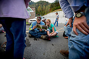 John Mullens and his cousin Michelle Mullens are killing time solving riddles in donated books while waiting to get in line to get a number for treatment line the morning after. More than 400 uninsured are lined up to get a check-up at the RAM Field Hospital in Grundy. Many of them spend the night sleeping in their cars outside the makeshift hospital to make sure they get treatment.
